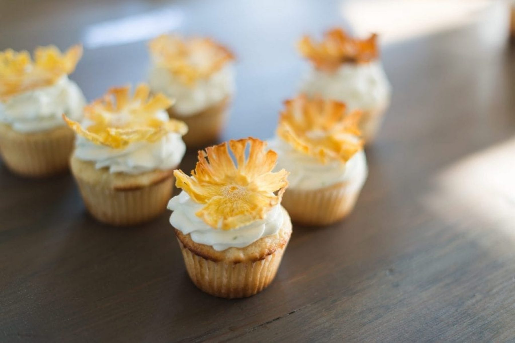 Blogger Ashley Pletcher is inspired by her trip to hawaii so she created a pineapple cupcake recipe with coconut lime frosting